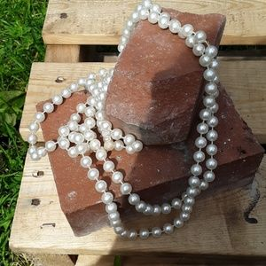 Long strand  necklace of faux pearls
